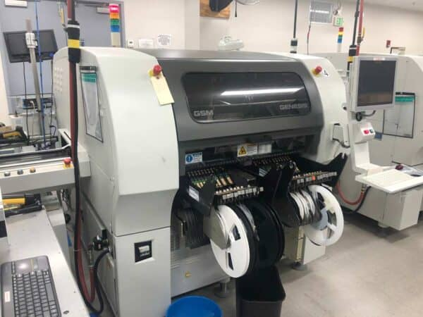 Front facing photo of a 2005 Universal Genesis GI-14D smt pick and place machine we have for sale.