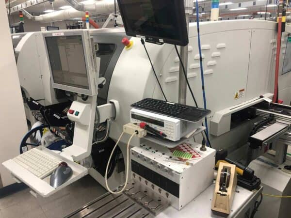 Right facing photo of a 2005 Universal Genesis GI-14D smt pick and place machine.